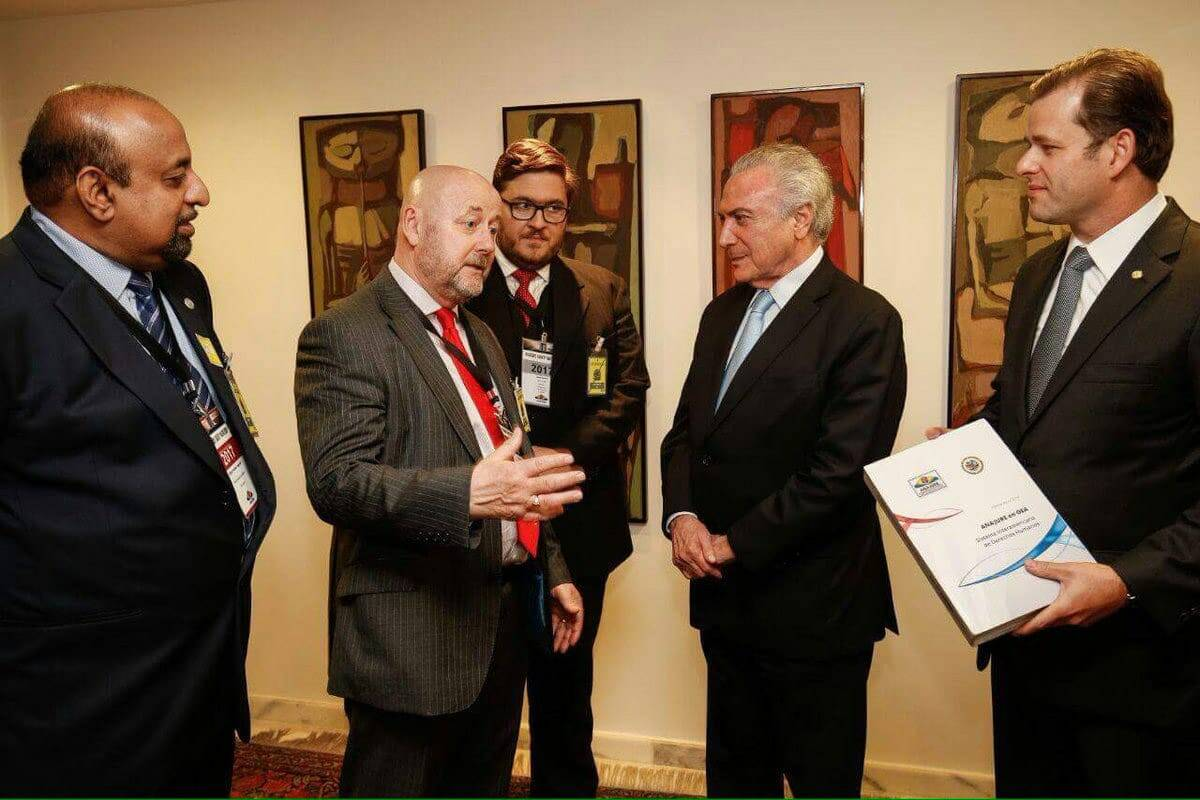 RLP Chairman, Mervyn Thomas, talking with former President of Brazil, Michel Temer. as RLP Leadership Team member Godfrey Yogarajah (far left) looks on. The RLP held its 2017 Consultation in Brasilia.